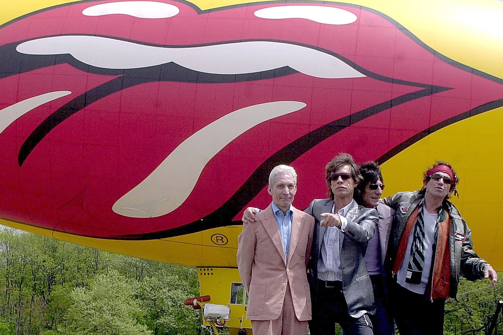 . After Landing In A Promotional Blimp, The Rolling Stones (L To R) Drummer Charlie Watts, Singer Mick Jagger, Guitarist Ron Wood And Guitarist Keith Richards Announce Their 2002-2003 World Tour May 7, 2002 In New York City\'s Van Cortlandt Park.  (Photo By Keith Bedford/Getty Images)