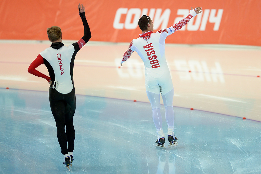 . Canada\'s Jamie Gregg and Russia\'s Denis Koval waive to the crowd after finishing their second race during the speed skating men\'s 500-meter at Adler Arena. Sochi 2014 Winter Olympics on Monday, February 10, 2014. (Photo by AAron Ontiveroz/The Denver Post)