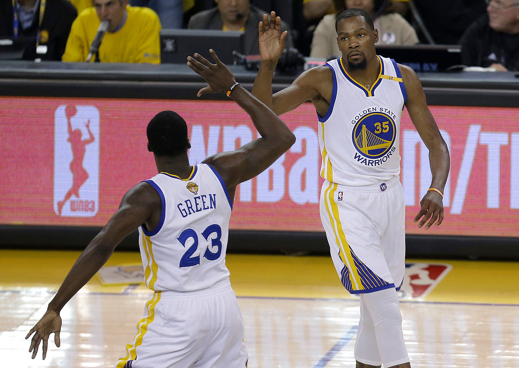 . Golden State Warriors forward Kevin Durant (35) and forward Draymond Green (23) celebrate during the first half of Game 2 of basketball\'s NBA Finals against the Cleveland Cavaliers in Oakland, Calif., Sunday, June 4, 2017. (AP Photo/Ben Margot)