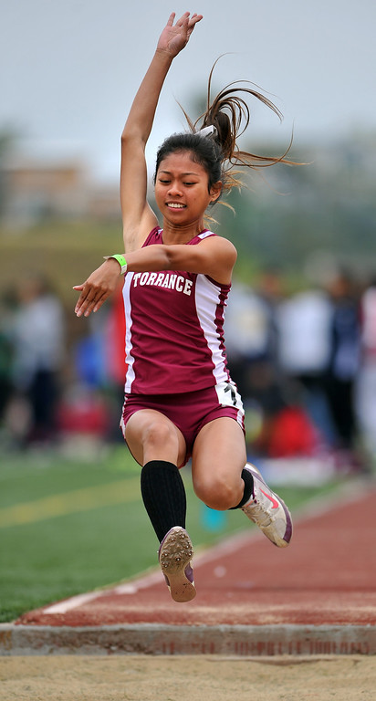 . 3/30/13 - Agatha Bato of Torrance High School, with a long jump of 15 feet, 6.5 inches at the Mustang Relays track and field events at Mira Costa High School on Saturday morning. Photo by Brittany Murray / Staff Photographer