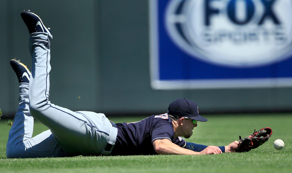 . Cleveland Indians center fielder Bradley Zimmer fails to catch a fly ball hit by Kansas City Royals catcher Cam Gallagher during the second inning of a baseball game at Kauffman Stadium in Kansas City, Mo., Sunday, Aug. 20, 2017. Royals Jorge Bonifacio scored on the play. (AP Photo/Orlin Wagner)