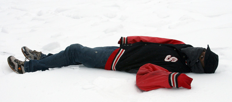 Jermaine Gash, sophomore, enjoys the snow outside HAPY Hall.