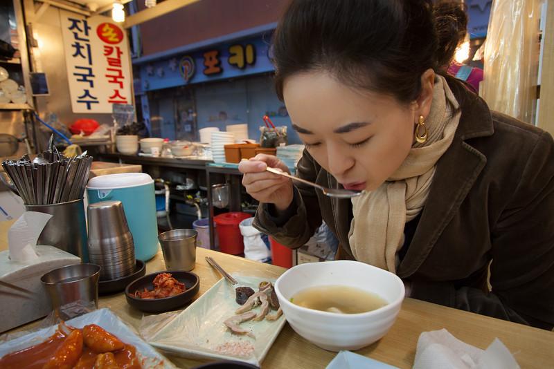 Eating (L-to-R) ddeokbokki, sondae, and some kind of soup.