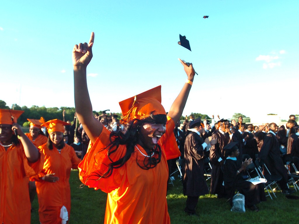 . Students celebrate at the end of the commencement ceremony at Chester High School Athletic Field, Friday. (Times Staff / JULIA WILKINSON)