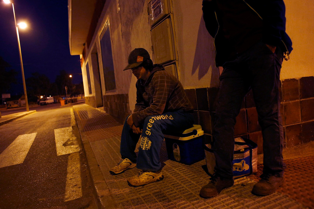 """. Day labourer Jorge Ibanez, 20, (L) waits to be picked up for a day\'s work harvesting potatoes in Pozo Estrecho, in the southern Spanish region of Murcia June 7, 2013. Ibanez quit school at the age of 16 to help pay the bills at home and did various different jobs before going back to complete his secondary education. Recently, he decided to start working as a day labourer. \""""I know for sure this is not what I want to do for the rest of my life, but this is all I can find now,\"""" he says. The majority of day labourers in the region come from Morocco and Ecuador, and it can be rare to see Spanish labourers in the fields. Nevertheless, as Spain wrestles with economic crisis and youth unemployment levels above 50 percent, some young Spaniards are starting to consider the kinds of jobs mostly performed by immigrants during the boom years.  Picture taken June 7, 2013. REUTERS/Susana Vera"""