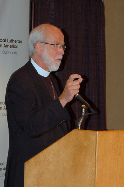 Presiding Bishop Mark S. Hanson explains a detail during the news conference.