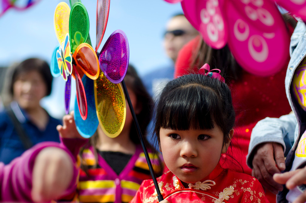 . Trily Phu, 6, of Alhambra walks around with a spinning flower toy during the 22nd Annual Alhambra Lunar New Year Celebration in Alhambra, Calif., Saturday, Feb. 16, 2013. The festival included food, rides, games and entertainment. (SGVN/Correspondent photo by Anibal Ortiz)