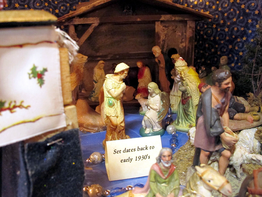 . In this Wednesday, Dec. 20, 2017 photo, a nativity scene from the early 1930s is on display at the home of Shirley Squires, in Guilford, Vt. Each Christmas she decks her home out with more than 1,400 such scenes and opens her home to school groups and others for viewing. (AP Photo/Lisa Rathke)