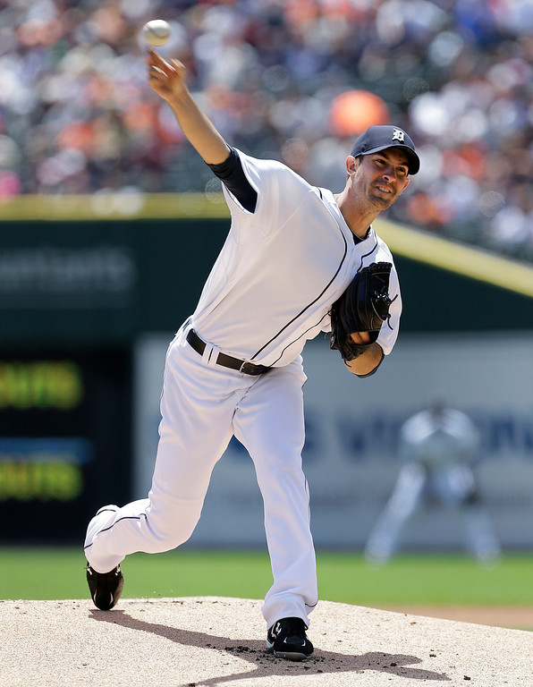 . Detroit Tigers pitcher Rick Porcello throws against the Minnesota Twins in the first inning of a baseball game in Detroit, Sunday, June 15, 2014. (AP Photo/Paul Sancya)
