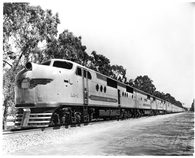 This publicity photo of LA-1 westbound at Mira Loma shows one of the few examples of an altered photo in UP's historical archives. The jointly-owned LA-1 was delivered with the 'T' nose medallion, which contained the logos of both UP and C&NW. This photo was altered for wartime advertising to use the nose medallion as was used only on UP-owned locomotives. Compare this photo with the other photo at Mira Loma, also of LA-1, but on an eastbound train, with the Overland Route bar across the UP shield. (Jeff Asay Collection)