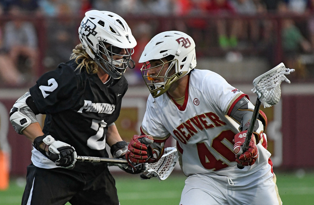 . DENVER, CO - MAY 05: Denver Connor Cannizzaro (40) tries to get around Providence Drew Custance (2) during the first period in a Big East semifinal game May 5, 2016 at Peter Barton Lacrosse Stadium. (Photo By John Leyba/The Denver Post)