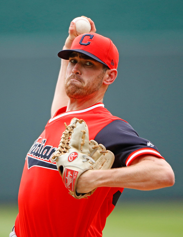 . Cleveland Indians starting pitcher Shane Bieber throws during the first inning of a baseball game against the Kansas City Royals Sunday, Aug. 26, 2018, in Kansas City, Mo. (AP Photo/Charlie Riedel)