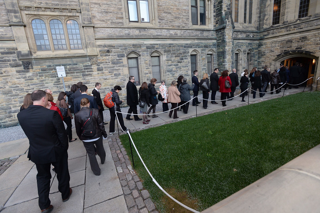 . Parliament staffers wait to enter Centre Block on Parliament Hill in the House of Commons on Thursday Oct. 23, 2014 in Ottawa. Michael Zehaf Bibeau fatally shot reservist Cpl. Nathan Cirillo on Wednesday, at the National War Memorial before setting his sights on Parliament Hill. Bibeau was killed just feet from where hundreds of MPs were meeting for their weekly caucus meetings. (AP Photo/The Canadian Press, Sean Kilpatrick)