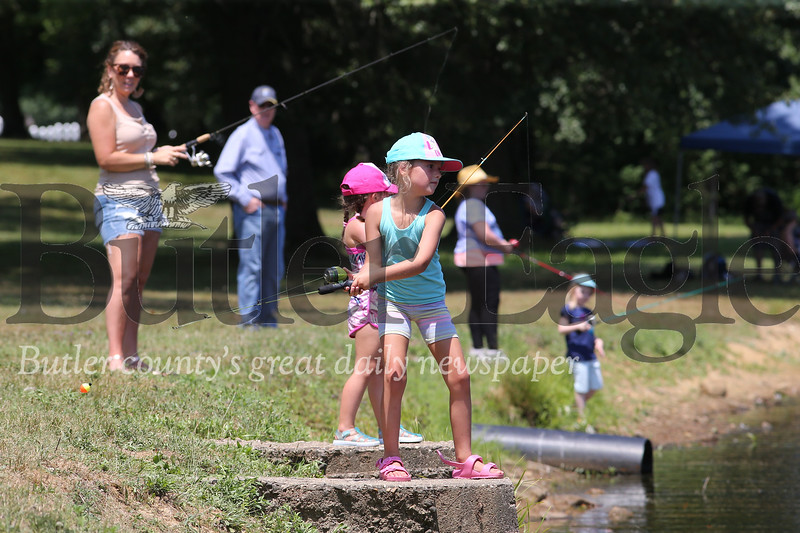 Emma Ross, 7, of Butler casts her line into Saxony Lake during Concordia's Kids Fishing Days Saturday at Saxony Farm Estates. Seb Foltz/Butler Eagle 07/26/20
