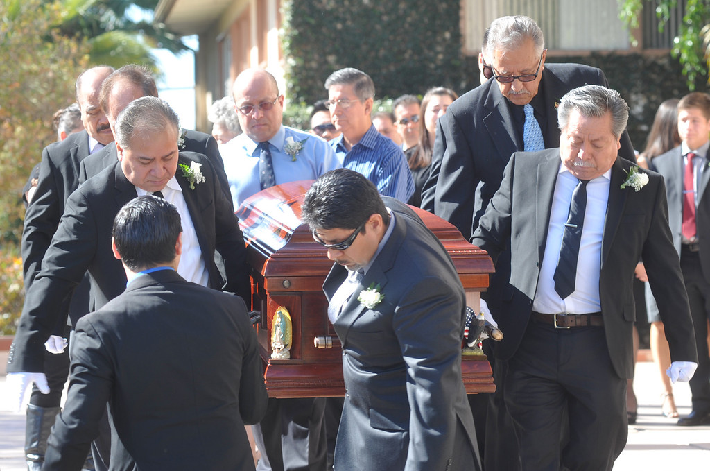 . Pall bearers bring out the casket to the hearse after the funeral service for Mario Jimenez, owner of Mario\'s Taco\'s, at St. Hillary\'s Catholic Church in Pico Rivera on Tuesday October 15, 2013. Jimenez who had been an active member of the community and hosted their free Thanksgiving dinners, died Wednesday October 8th after a long battle with cancer. (Whittier Daily News/Staff Photo by Keith Durflinger)