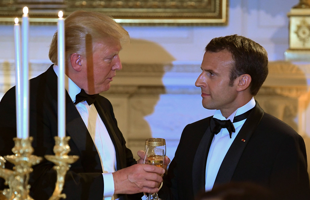 . President Donald Trump, left, and French President Emmanuel Macron, right, share a toast during the State Dinner at the White House in Washington, Tuesday, April 24, 2018. (AP Photo/Susan Walsh)