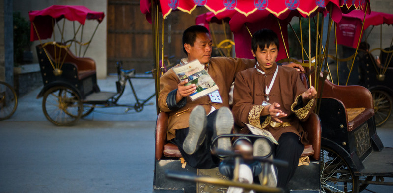 """Cart Runners in Old Beijing There are many old pockets scattered all over Beijing.  I haven't become totally familiar with all the names of these quadrants yet, but I should get another chance to re-visit all these places.  This is actually kind of a weakness in the whole """"travel blog"""" thing.  See, a REAL travel blogger would memorize the names of all these places and spout them back to you.  But, here is my excuse... and maybe it is not really that bad... but, to me, this kind of photo could be taken in many different places.  The exact neighborhood does not matter.  In fact, by NOT telling you the spot, you may be more likely to find it just by wandering about.These uniformed guys sat together in between jobs and had a rest.  I don't know what struck me about it, but it just seemed like a nice little moment. - Trey RatcliffClick here to read the rest of this post at the Stuck in Customs blog."""