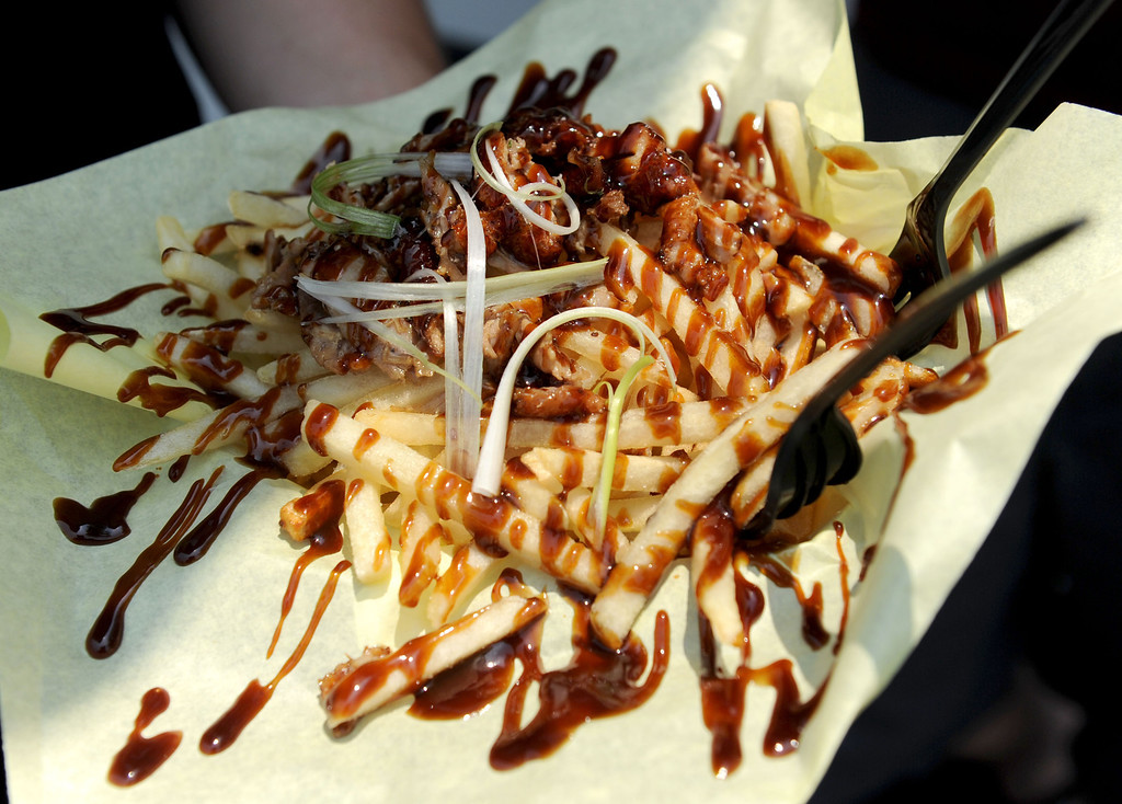 . (John Valenzuela/Staff Photographer) An order of Peking Duck Fries from the Phantom Food Truck during the second annual Food Truck and Brewfest in Redlands Saturday, June 29, 2013.