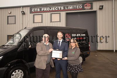 Ken Brundle and Vickie Chambers from Ulster Wildlife present Connaire McGreevy from CTS Projects with a certificate  to scknowledge them as a Silver Level Corporate member. R1604004
