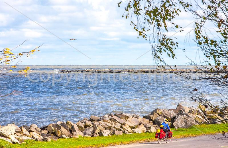 Lake Erie -- Touring Cyclist on South Shore Near Ashtabula