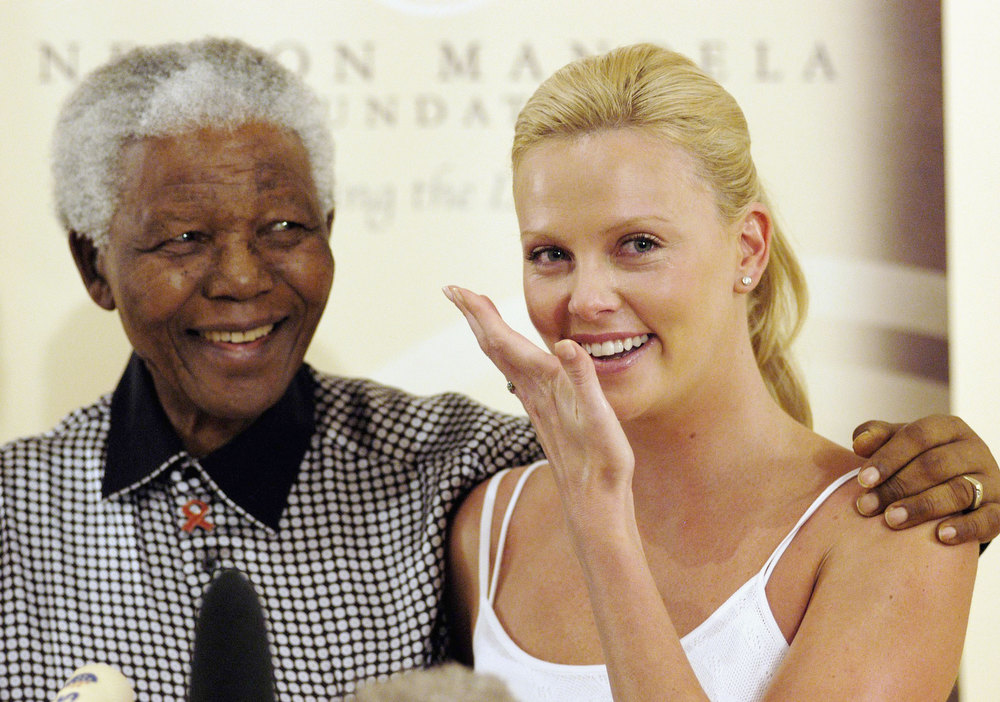 Description of . Oscar winning Actress Charlize Theron wipes away tears as she meets former South African President Nelson Mandela at Mandela House following her Academy Awards success, on March 11, 2004 in Johannesburg, South Africa. (Photo by Naashon Zalk/Getty Images)