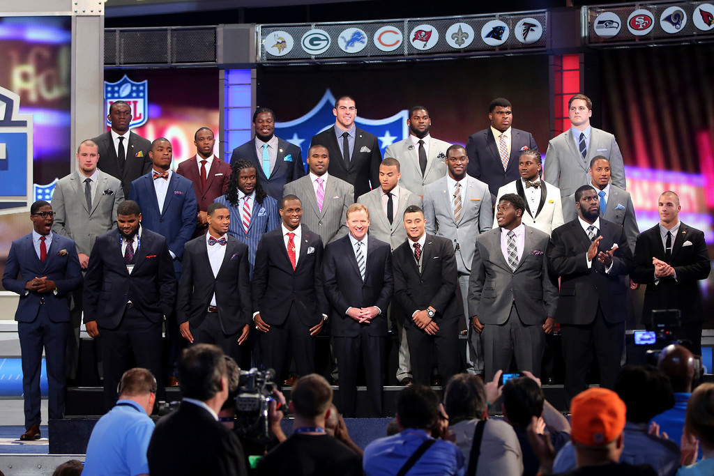 . The top NFL football draft prospects pose for a group photo with Commissioner Roger Goodell, front row center, before the first round, Thursday, April 25, 2013, at Radio City Music Hall in New York. (AP Photo/Mary Altaffer)