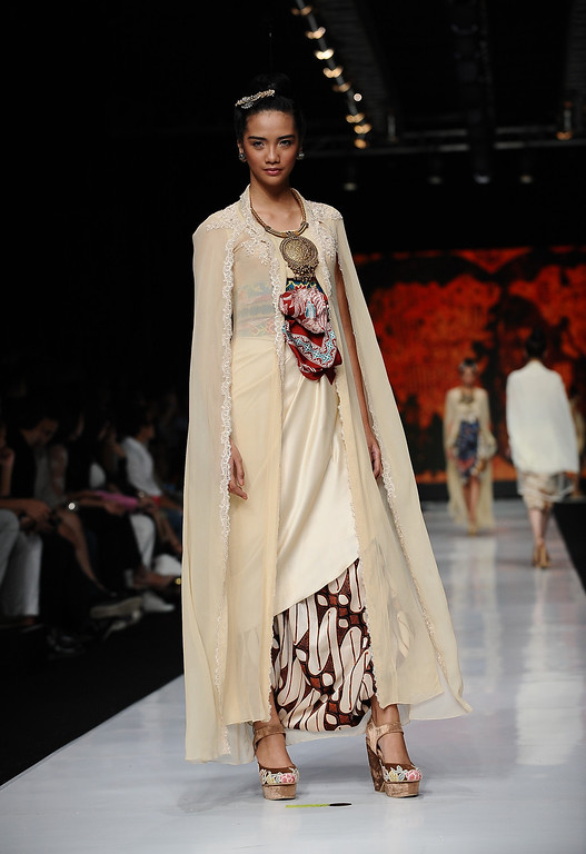 . A model showcases designs by Era Soekamto on the runway at the Indonesian Fashion Designer Council show during Jakarta Fashion Week 2014 at Senayan City on October 21, 2013 in Jakarta, Indonesia.  (Photo by Robertus Pudyanto/Getty Images)