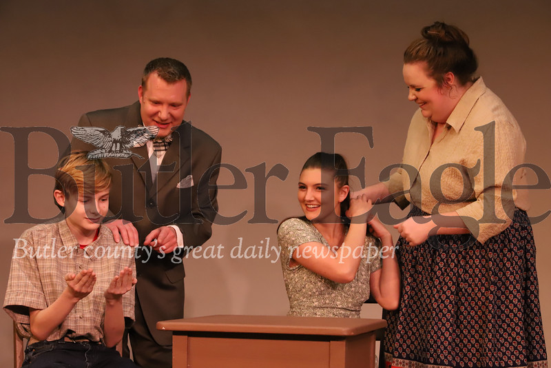 """(Left to right) Conner Yelich, Daniel Scheller, Taryn Pfeifer and Ariana O'Donnell rehearse a Webb family breakfast scene in the Butler Little Theatre's production of """"Our Town."""" Seb Foltz/Butler Eagle"""