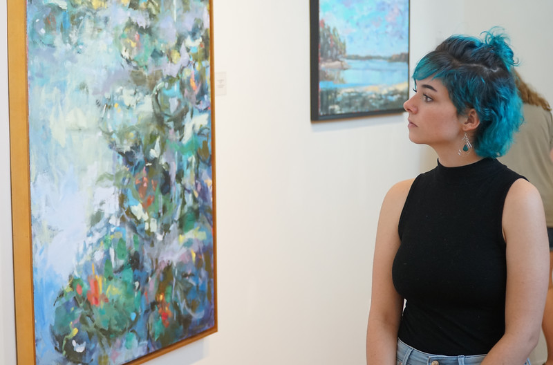Junior Gardner Webb student Sarah Rochester admires one of the art pieces.