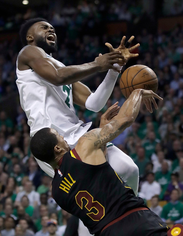 . Cleveland Cavaliers guard George Hill (3) defends as Boston Celtics guard Jaylen Brown drives to the basket during the third quarter of Game 5 of the NBA basketball Eastern Conference finals Wednesday, May 23, 2018, in Boston. (AP Photo/Charles Krupa)