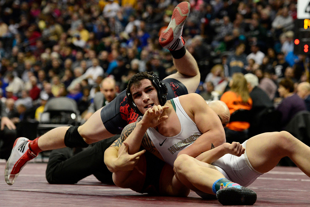 . DENVER, CO - FEBRUARY 23: Highland 145-pounder James Price turns Wyatt Wade of Dolores for a fall in 1:09 in the class 2A final during the Colorado State High School Wrestling Championships. The state\'s top wrestlers squared off in four classes in front of a near-capacity crowd at the Pepsi Center. (Photo by AAron Ontiveroz/The Denver Post)