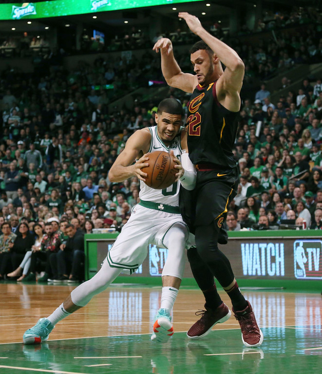 . Boston Celtics forward Jayson Tatum drives against Cleveland Cavaliers forward Larry Nance Jr. during the second half in Game 7 of the NBA basketball Eastern Conference finals, Sunday, May 27, 2018, in Boston. (AP Photo/Elise Amendola)