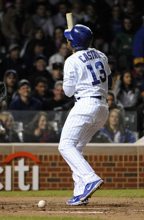 . Starlin Castro #13 of the Chicago Cubs reacts after being hit by a pitch against the Colorado Rockies during the fourth inning on May 13, 2013 at Wrigley Field in Chicago, Illinois.   (Photo by David Banks/Getty Images)