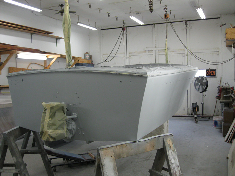 Rear starboard view of sides, bottom and transom primed.