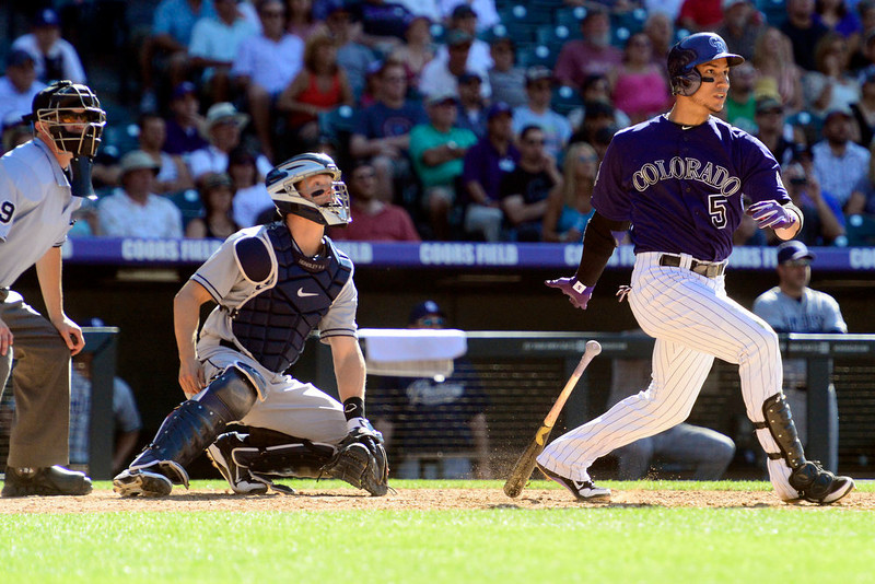 . DENVER, CO - JUNE 9: Colorado Rockies left fielder Carlos Gonzalez (5) knocks in the game-tying runs with a two-run double against the San Diego Padres during the Rockies\' 8-7 10-inning win in Denver. The Colorado Rockies hosted the San Diego Padres. (Photo by AAron Ontiveroz/The Denver Post)