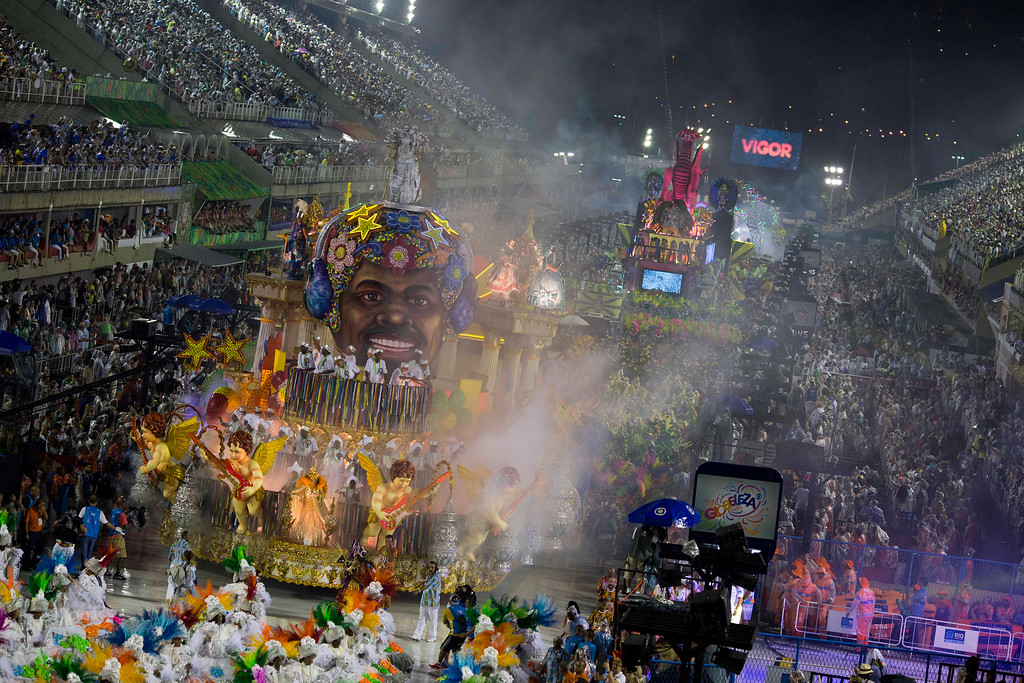 . Performers from the  samba school parade on a float during Carnival celebrations at the Sambadrome in Rio de Janeiro, Brazil, Sunday, Feb. 26, 2017. (AP Photo/Mauro Pimentel)