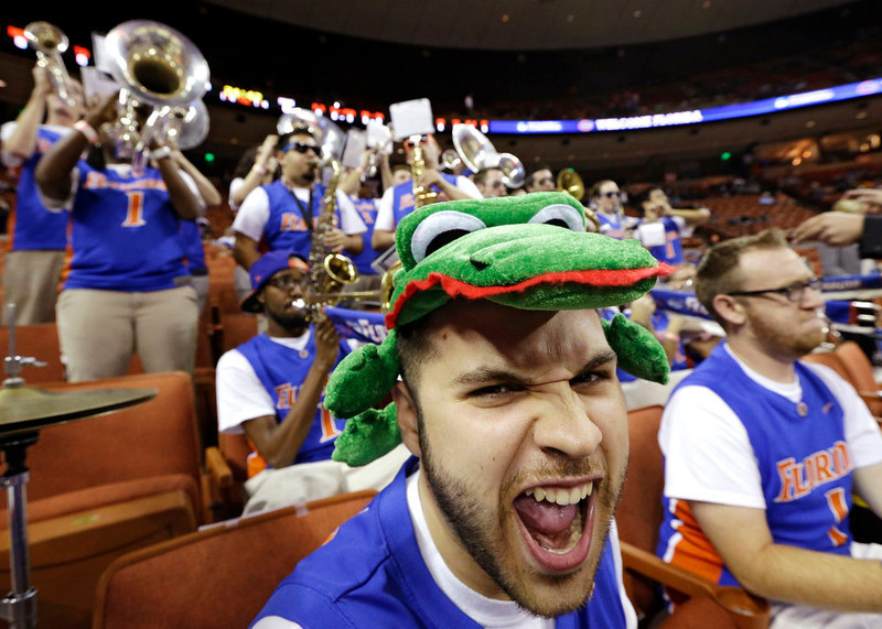 . Florida band member Michael Thomas plays before a third-round game against Minnesota in the NCAA college basketball tournament, Sunday, March 24, 2013, in Austin, Texas. (AP Photo/David J. Phillip)