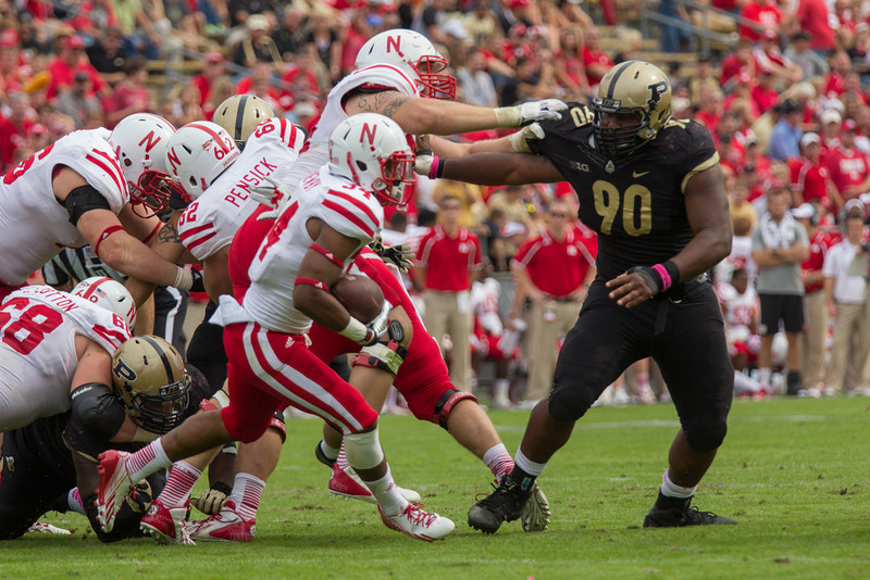 Bruce Gaston (90) tries to corral Terrell Newby (34) during the fourth quarter of the Big Ten Conference game between the Purdue Boilermakers and the Nebraska Cornhuskers on October 12, 2013