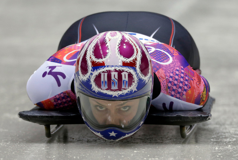 . Noelle Pikus-Pace of the United States starts her final run during the women\'s skeleton competition at the 2014 Winter Olympics, Friday, Feb. 14, 2014, in Krasnaya Polyana, Russia. Pikus-Pace won the silver medal. (AP Photo/Natacha Pisarenko)
