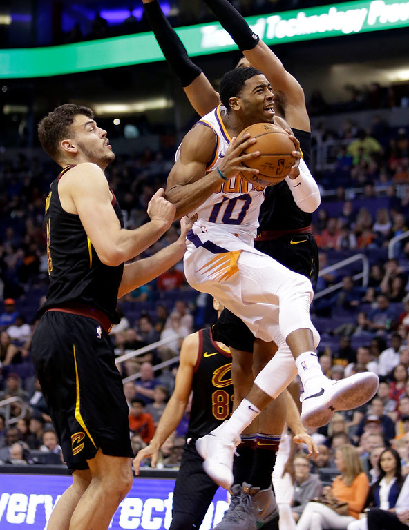 . Phoenix Suns guard Shaquille Harrison (10) drives past Cleveland Cavaliers forward Ante Zizic in the second half of an NBA basketball game, Tuesday, March 13, 2018, in Phoenix. The Cavaliers defeated the Suns 129-107. (AP Photo/Rick Scuteri)