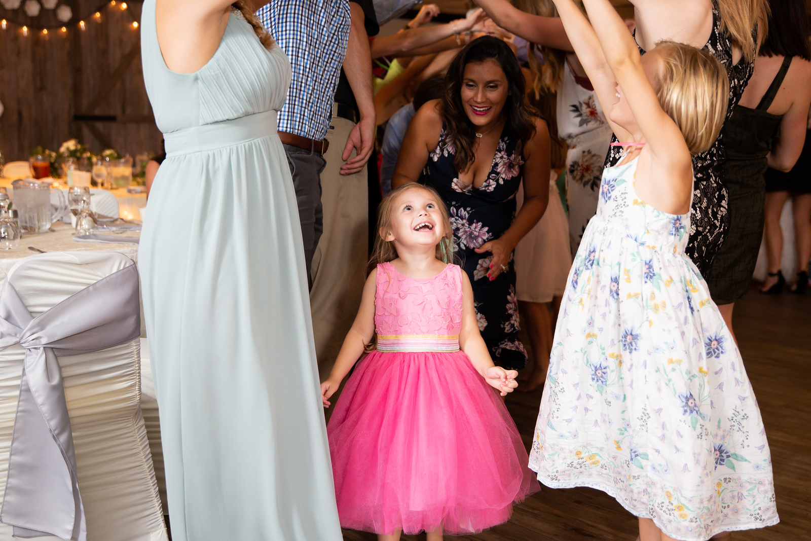 Family has fun dancing at the wedding reception