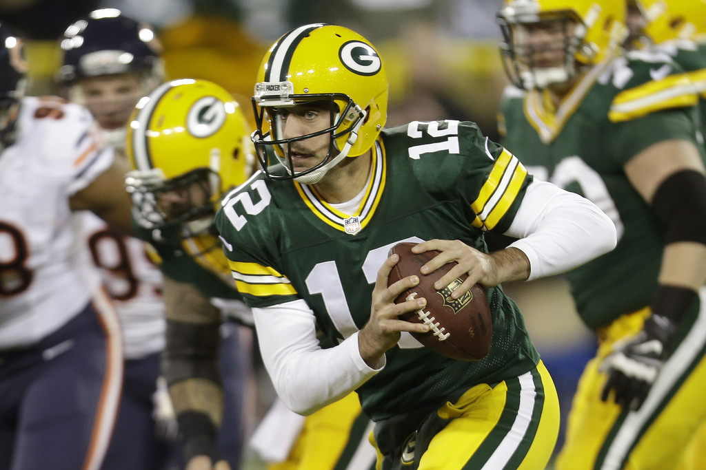 . Aaron Rodgers #12 of the Green Bay Packers scrambles out of the pocket during the first quarter against the Chicago Bears at Lambeau Field on November 04, 2013 in Green Bay, Wisconsin. (Photo by Mike McGinnis/Getty Images)