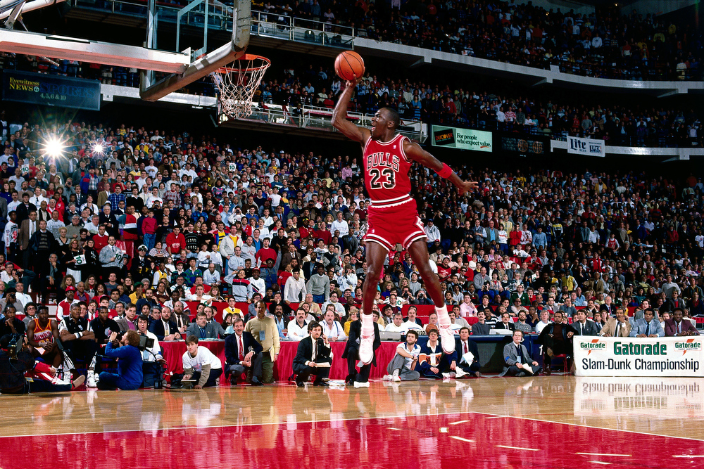 Description of . 7 Feb 1988: Michael Jordan #23 of the Chicago Bulls goes for a dunk during the 1988 NBA All Star Slam Dunk Competition at Chicago Stadium in Chicago, Il. Jordan went on to win the Slam Dunk Competition.   Andrew D. Bernstein/NBAE/Getty Images