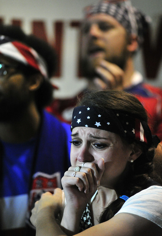 . Casey Papp, of Huntsville, cries as the U.S. loses while fans showed up at Straight to Ale Brewery to watch the U.S. play Belgium in a World Cup soccer match Tuesday, July 1, 2014, in Huntsville, Ala. (AP Photo/AL.com, Eric Schultz)