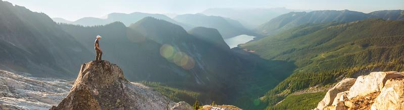 A climber looks down at Jones Lake (Wahleach Lake) from a  granite bluff below Foley Peak.