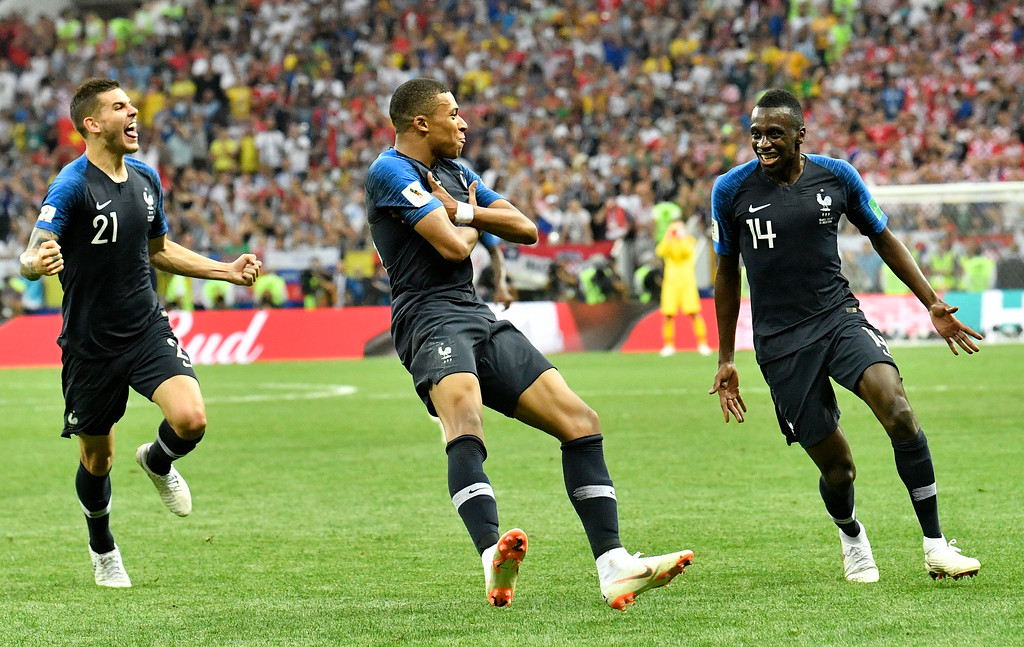 . France\'s Kylian Mbappe, center, celebrates after scoring his side\'s fourth goal during the final match between France and Croatia at the 2018 soccer World Cup in the Luzhniki Stadium in Moscow, Russia, Sunday, July 15, 2018. (AP Photo/Martin Meissner)