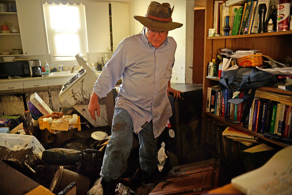 . Manitou Springs, CO. - July 02: Steve Brunette tries to climb out of the kitchen of his home that is filled with mud after a flash flood washed through houses, streets and businesses when a downpour hit the Waldo Canyon burn scar in El Paso County July 02, 2013 Manitou Springs, Colorado. (Photo By Joe Amon/The Denver Post)