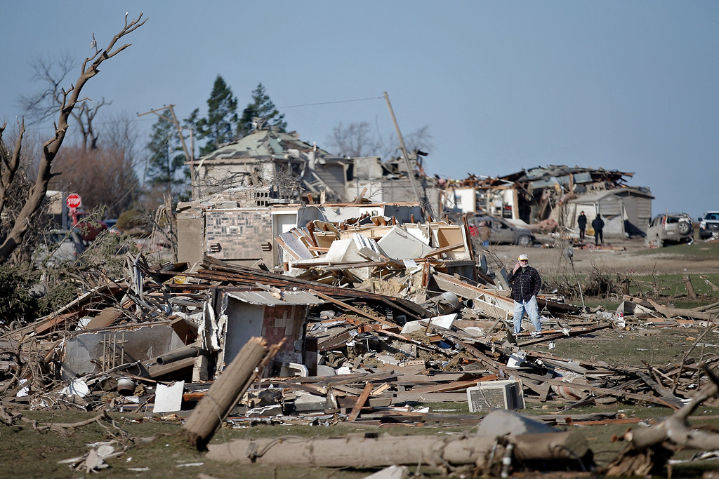 . Michael West surveys the damage of his mother\'s home on IL-64 after a tornado swept through the night before, on April 10, 2015 in Rochelle, Illinois. According to reports, 11 people were injured and one person was killed when tornadoes and thunderstorms passed through the northwestern suburbs of Chicago. (Photo by Jon Durr/Getty Images)