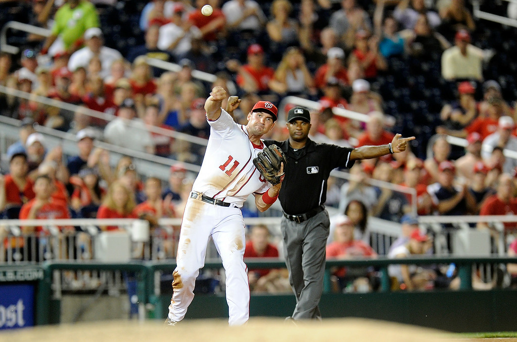 . WASHINGTON, DC - JUNE 30: Ryan Zimmerman #11 of the Washington Nationals throws the ball to first base to double off Corey Dickerson #6 (not pictured) of the Colorado Rockies in the seventh inning at Nationals Park on June 30, 2014 in Washington, DC.  (Photo by Greg Fiume/Getty Images)