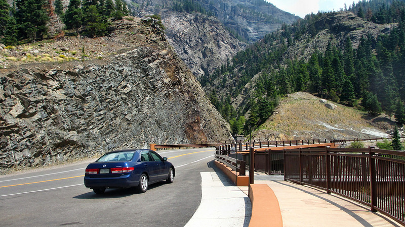 Driving over 11,018 feet Red Mountain Pass on the Million Dollar Highway US550 between Grand Junction, CO, to Durango, CO